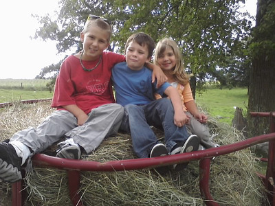 2nd cousins, Cole, Izaak, Jr, and Ella rested on a haystack in the pasture.  Little Izaak smirks like Gramma Heidi when smiling for the camera.  :)