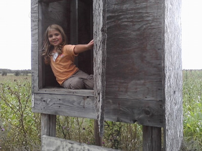 "Ella, my grand-niece, sitting in hunting shack, in her ""Grampa"" Ed's pasture."