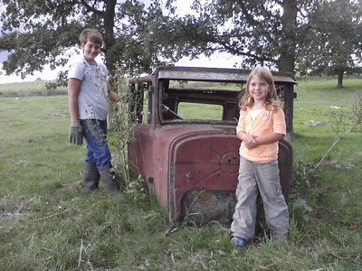 Jack and Ella, my niece's kids, showed me the metal shell of an antique car left there in the pasture a long time ago by previous owners of Ed's farm.  We three wondered about it.
