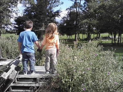 Izaak Jr. and Ella hold hands.  He - 5 years old, Ella - 4 years old.