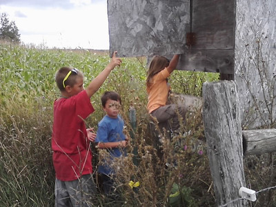 The kids explored a hunting shack situated in the pasture on Ed's farm.  From left to right: Cole, Izaak, Jr., and Ella.