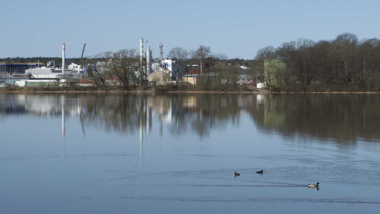 The Pfizer (former Pharmacia, Kabi)  and DSM (former Gist brocades, Fermenta) sites, seen from the east at Gåsskär/Gorsingeholm. 2007 April 14 @ 10:23