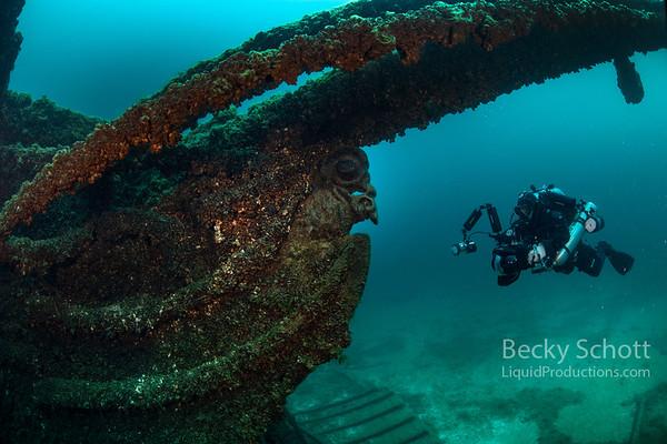 Shane photographing the figurehead on the brig Sandusky in the Straits of Mackinac