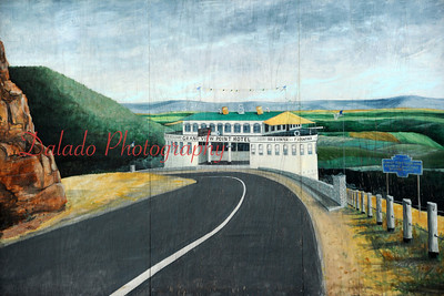"""A mural dedicated to the S.S. Grand View on Route 30 in Pa. (The Grand View was a restaurant shaped like a ship that sits on top of a mountain with a """"grand"""" overlook. After switching hands a view times, the place burnt down in the early 90s. All that is left is the rock wall and the shell of an old gas station across the street.)"""