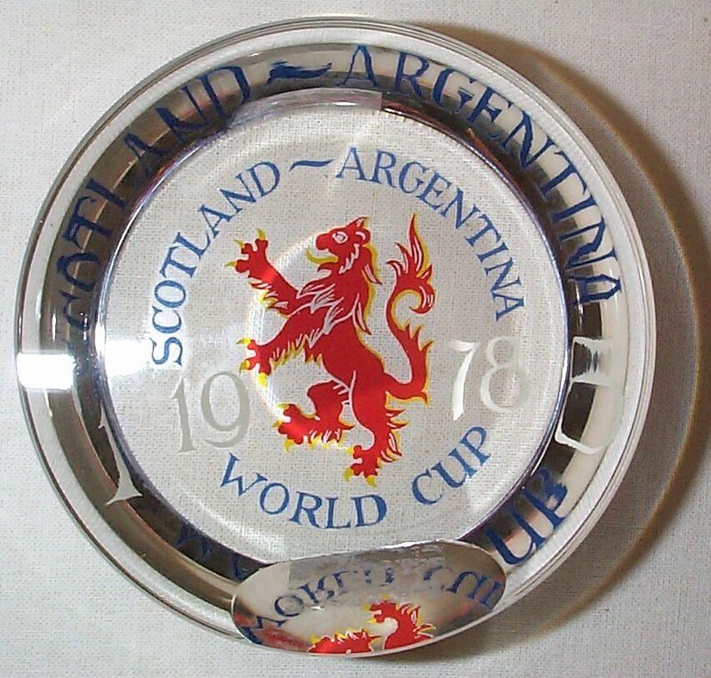 "DCP04627 Scotland/Argentina 1978 World Cup...Strathearn Commemorative Scotland-Argentina 1978 World Cup football or soccer weight in a Portrait Style and clear ground, 3.18"" x 1.4"" and 16 ozs. Portrait Style with a top and side facet. All of Strathearn's pwts that have a side facet for standing the weight on its side and having a top facet are called ""Portrait"" weights. Flat cut polished base. Etch signed over top of side facet ""Strathearn"". Not otherwise signed or dated. No label. Circa 1978 only. Very limited production but total unknown at this time. I've seen only one other one to date. acquired 04-01-05."
