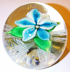 """DCP04951D4-S70 Turquoise... Strathearn D4 S70 magnum turquoise flower over five double latticino twists and a clear ground, 3.85"""" x 3.2"""" and 40.0 ozs. Flat cut polished base. No label. Signed and dated black cane with a yellow S on base and a yellow and white 70 cane in the center of the flower. Discontinued May 1, 1978. acquired 11-15-10."""