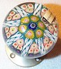 "DCP04526DK1-Doorknob Millefiori P8...Strathearn DK1 doorknob millefiori 8 spoke in a 1-2-2 design cartwheel on a powder blue ground, 2.45"" x 3.25"" & 13 ozs. Unused Satin Chrome pin boss base. Black Strathearn label. circa 1965 to 1978. Discontinued May 1, 1978. acquired 09-24-03."