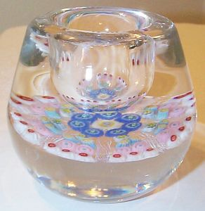 "DCP04467PE-Candleholder....Strathearn Experimental Magnum millefiori 7 spoke cartwheel candleholder on clear ground 3.3"" x 2.9"" & 28 ozs. Concave unfinished rough base. No label. circa 1979 to 1980. acquired 01-17-03."