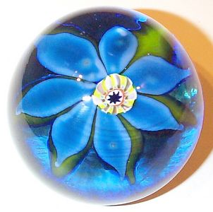 """DCP04451PE Blue Flower....Strathearn Experimental Rare seven petal blue flower with a 1979 to 1980 complex center cane on a translucent blue ground, 2.6"""" x 1.95"""" & 12 ozs. Concave fire-polished smooth base. No label. circa 1979 to 1980. acquired 01-17-03."""