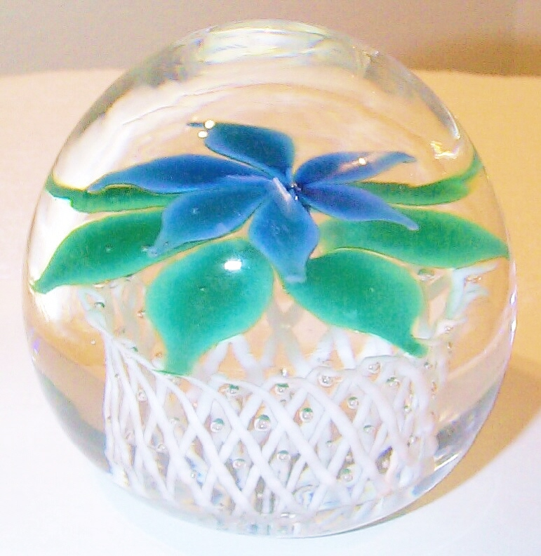 "DCP04462PE-D4Type Blue Flower....Strathearn Experimental magnum six petal blue flower & six uniform green leaves over a fantastic 1.5"" tall white crisscross lattice basket & clear ground 3.7"" x 3.4"" & 39 ozs. Concave fire-polished rough pontil mark base. No label. circa 1979 to 1980 & made by Herbert Dreier. acquired 01-17-03."