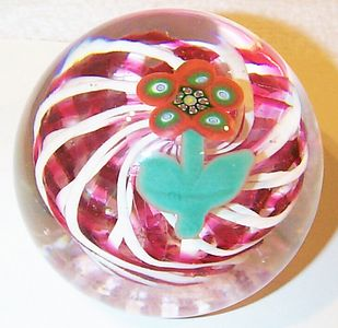 """DCP04444PE-Red&White Spiral Flower....Strathearn Experimental Magnum five petal millefiori flower over a stunning double translucent ruby red & white spiral lattice basket & clear ground, 3.4"""" x 2.7"""" & 29 ozs. Concave polished base. No label. circa 1979 to 1980 and was made by Herbert Dreier. acquired 01-17-03."""