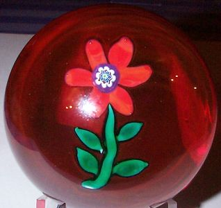 """DCP04443PE-Red Flower....Strathearn Experimental six petal Red Flower & green stem & leaves on a ruby ground 3.0"""" x 2.4"""" & 19 ozs. Center cane is a known Paul Ysart cane. Flat cut fire-polished rough pontil mark base. No label. circa 1965 to 1970 or older. acquired 01-17-03."""