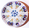 "P10 Millefiori Signed and Dated Large : These Strathearn P10 Large signed and dated millefiori cartwheel or spoke weights are some of the best that Strathearn made over the years. They were a special series made each year, were of a large size from 2.9"" to 3.3"", always on a clear ground and were always signed and dated. They were made with 7, 8, 9, and 10 spokes and in a 1-1-2 design, a 1-2-2 design, a 1-2-3 design and a 1-2-2-3 design that I have found so far. At this time I don't have any definitive proof that they were a limited edition weight but they rarely show up so for the time being I am assuming that they were a Limited Edition and probably limited to around 100 to 150 per year. Not exactly sure when they were first made but the earliest ones that I've found are dated 1969. They were only made until mid 1978 as the Strathearn brochure that I have indicates that they were discontinued on 1 May 1978 but I do have one dated 1979 and this 1979 one is probably very rare as it is the only one that I've ever seen to date. Also according to Dave Moir, he said that there were not a lot of these P10's made but it was impossible for him to remember how many of each pwt that was made and that these were ""special up market types""."