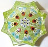 P11 Millefiori Star Spoke Large : This is Strathearn's largest eight pronged star weight using the standard cartwheel or spoke design. It was a regular production item and as with a number of Strathearn's Pwt production quanities were made as needed, if they sold more they made more. This large Star Spoke weight ranges in size from 2.7 to just over 3.2 inches. They always have a colored ground, at least I've never seen one made on a clear ground. These are mould pressed weights.