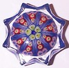 "P12 Millefiori Star Medium or Small : Strathearn designated these as Small Star weights but I've found these ranging from about 2.2"" to about 2.7"" so I have split this star weight catagory into medium stars at about 2.45"" to about 2.7"" and small stars at about 2.2"" to about 2.45"". These were regular production weights and production was based on need, the more sold the more made. These are mould pressed star weights and were made from 1965 until at least through 1979."