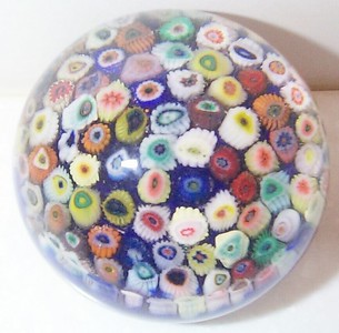 """DCP04014P15...Strathearn P15 Small Carpet Millefiori Closepack on a royal blue ground, 2.4"""" x 1.9"""" and 10 ozs. Flat cut polished base. No label. Circa 1965 to 1980. Sold"""