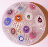 "DCP04985P22... Strathearn P22 small lace with eleven spaced millefiori canes, 2.45"" x 1.775"" and 9.0 ozs. Flat cut polished base. Black Strathearn label. circa 1965 to 1970. Discontinued 1 May 1978. acquired 04-12-11."