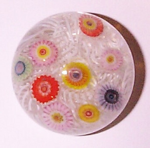 """DCP04809P23-1... Strathearn P23 minature lace with nine spaced millefiori canes, 1.6"""" x 1.3"""" and 3.0 ozs. Flat cut polished base. No label. circa 1965 to 1977. acquired 10-01-08."""