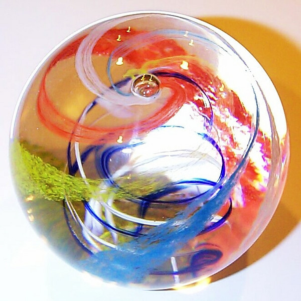 "DCP04947P40 Cyclone... Strathearn P40 Cyclone with multicolored ribbons swirling around opposing ribbons of color in a clear glass weight, 2.95"" x 2.55"" and 19.5 ozs. Concave fire-polished smooth pontil mark base. No label but came in an original Strathearn box. Not signed or dated but first introduced in May of 1978. acquired 10-30-10."