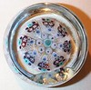 "PP10 Millefiori Large Signed and Dated Top & Side Facet : This is the signed and dated PP10 with the same description as the regular signed P10 version except with a top facet and a side facet for standing the pwt on edge for presentation. The first one has an ""S74"" date cane in it while the second one is an ""S71"" The earliest signed and dated Strathearn millefiori I've found to date is an ""S69"" P10 so it's quite possible that these PP10's were also made as early as 1969. A copy of Strathearn's Trade brochure for 1978 that I have shows the P10 being discontinued in May of 1978 but the PP10's are not listed at all suggesting that they were discontinued at an earlier date possibly around 1977 or earlier. As with many of Strathearns pwts I don't know what the edition size is for this weight. Again, the ""PP"" designation is for a ""Portrait Paperweight"". All of Strathearns various paperweights with a top and side facet were classified as ""Portrait Paperweights"". To date these are the only two of these I've seen. While I had only the ""S74"" one and it being the only one I'd seen in almost eight years I had originally assumed that this weight was a possible regular P10 gone wrong and faceted to save the weight or perhaps originally earmarked for an Overlay paperweight but now that I've found two of them I'm inclined to believe that a PP10 designation did actually exist. The only way I'll know for sure is if I can ever find a copy of a Strathearn brochure or catalog dated prior to 1977."