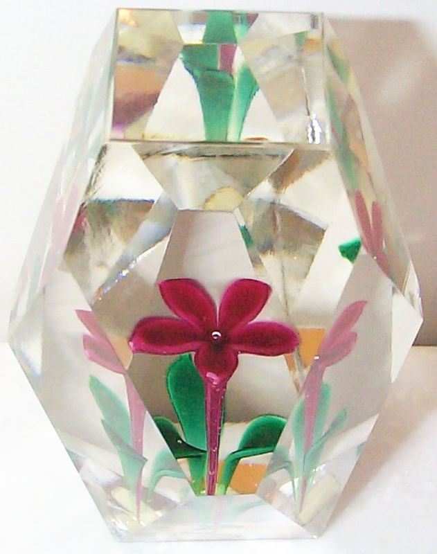 "DCP04186PSMF623 Flower Upright... Strathearn multi-faceted on all sides PSMF623 Flower upright in red in a clear glass weight with a top facet and twelve side facets, 3.45"" tall x 2.3"" wide and 14 ozs. Flat cut polished base. No label. circa 1967 to 1979 and perhaps into 1980. acquired 08-06-01."