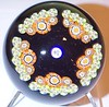 "SP101 Patterned Millefiori : This is the Strathearn SP101 Patterned Millefiori weight. In 1979 Strathearn came out with three new paperweight series, the SP series (which was the basic design for the other two series), the PPS series and the PSFS series. Each of the three newly introduced series had three new pwt designs designated as 100, 101 and 102. The three basic designs were the concentric millefiori which is shown in the SP100 album, the patterned millefiori which is shown in this album and the garland millefiori which can be seen in the SP102 album. The Strathearn Trade brochure states of these new pwts...""Our new range of paperweights of millefiori designs to be limited to 500 pieces in each design and style. Each weight will be signed, numbered and authenticated and supplied in a special horseshoe presentation box."" As with almost all of the special faceted and multi-faceted and collectors range of pwts Strathearn did not always sign, date and number each and every weight, some weights...yes, some weights...partially and on others only on the authentication card. The Trade brochure copy that I have is not dated so I do not know exactly when in 1979 these were first introduced but they were carried on into 1980 as I have some dated 1980 and have seen others."