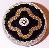 """DCP04798SP102 Garland... Strathearn SP102 limited edition Garland Millefiori on a black cushion ground, 2.825"""" x 2.35"""" and 17 ozs. Flat cut polished base. No Label. Not signed or dated but definitely either 1979 or 1980. acquired 08-03-08."""