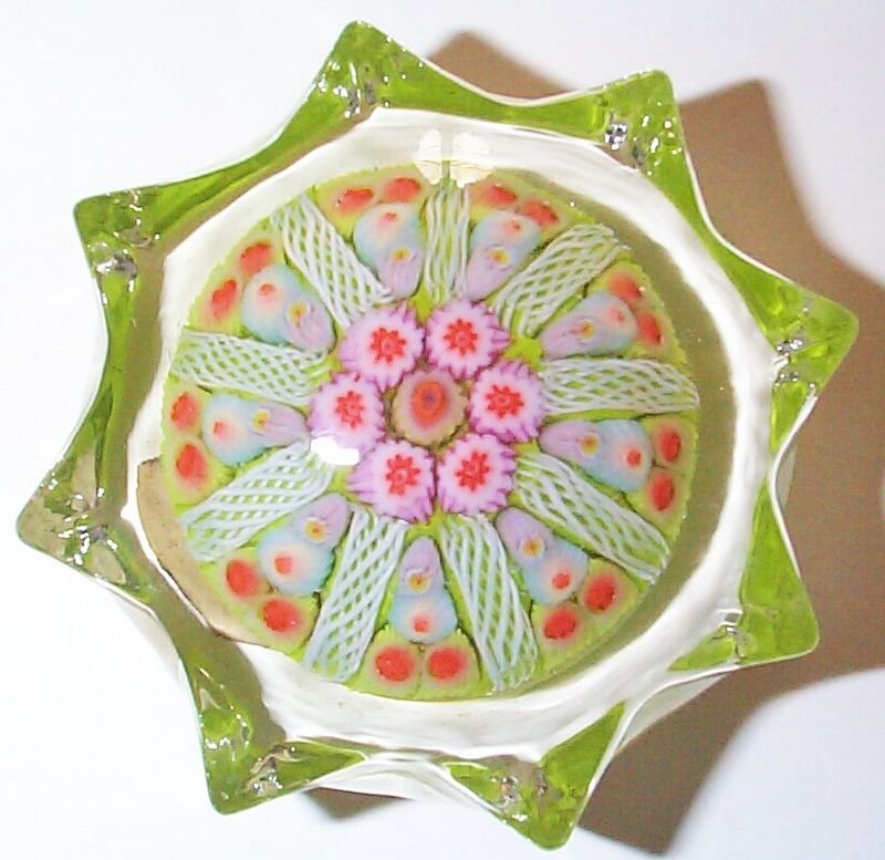 """DCP1976-4478P12 Star Spoke....Strathearn P12 """"1976"""" Medium/small 9 spoke millefiori star in a 1-1-2 design cartwheel on a lime green ground, 2.6"""" x 1.35"""" & 8 ozs. Concave fire-polished smooth pontil mark base. Black Strathearn label. Circa 05-28-76 Original Invoice signed by Angus Sillars Managing Director. acquired 02-24-03."""