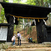 A Black Gate.<br /> This is one of the gates you have to pass to get to the top. The rope and paper is there because according to Shito belief it keeps out evil spirits.