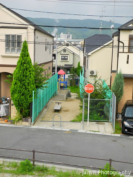A Narrow Gap between the Houses.<br /> Utilised as both a walkway and a park.