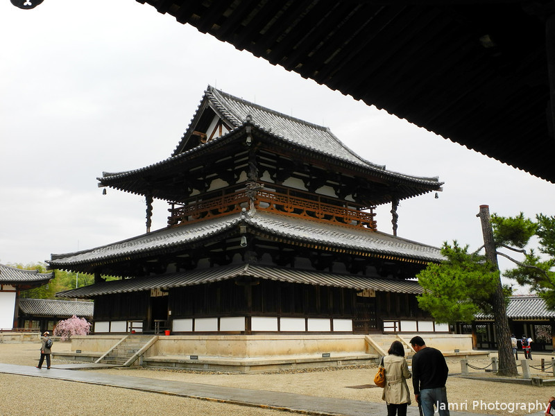 Inside the Grounds of Houryu-ji.<br /> Looking at the oldest wooden building in world the Kon-do of Houryu-ji.<br /> Dating back to around the late 7th century AD.