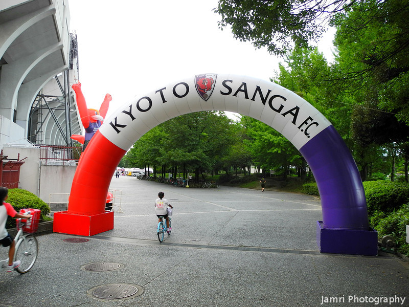 Kyoto Sanga F.C.<br /> Went to a Soccer Game with Yu who is one of my students, he hopes to be a Soccer Club manager one day. Kyoto Sanga's colours are mostly purple with red and white. My favourite AFL (Aussie Rules) team is the Fremantle Dockers, whose colours are Purple and White (they used to have Red and Green also in the colours), so I feel there's a connection even though it's a different kind of football. I wore my Purple Fremantle Dockers polo-shirt and blended right in with the rest of the crowd.