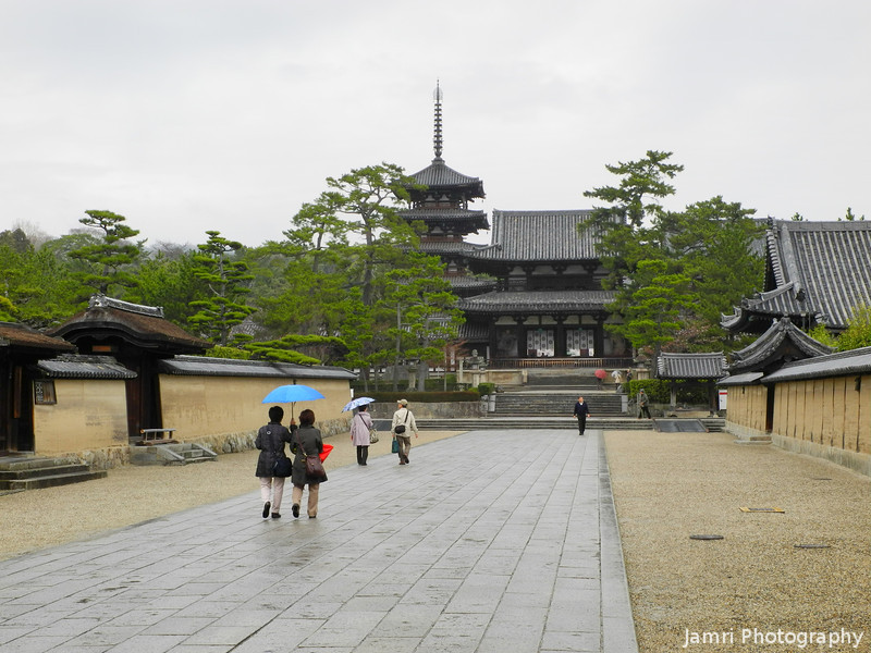"""The Road to Houryu-ji Temple.<br /> This temple in Nara prefecture was Japan's first UNESCO world heritage site. In the grounds are some of the oldest wooden buildings in the world. It was founded in 607 by Empress Suiko and Prince Shoutoku.<br /> Prince Shoutoku is a mysterious figure who ruled Japan as a regent prince. He wrote Japan's first constitution. However he died before he could become Emperor. Some say he was killed because he converted to Keikyo (""""the religion of the light"""", ie what Christianity was called before the arrival of Francisco Xavier, since Xavier's time Christianity has been called Kirisutokyo in Japanese). There are some books available in Japanese about Houryu-ji talk about hidden evidence in the temple buildings that point to Shoutoku's conversion.<br /> We have an interest in looking for evidence of pre Xavier Christianity and Judaism in Japan, so we decided to make the long trip (from Nagaokakyo out to Houryu-ji) via three trains and a bus."""
