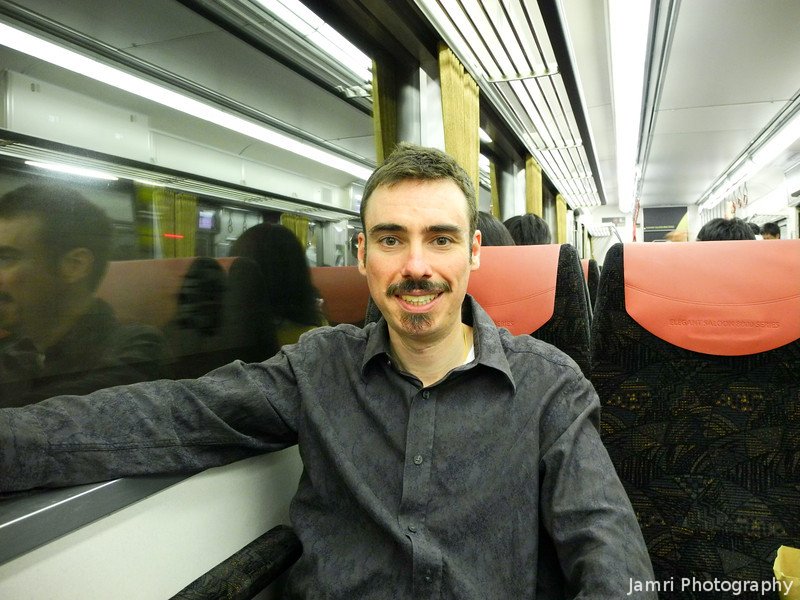 "Me on a Keihan Train. Sorry I'm not as pretty as an <A href=""http://jamri.smugmug.com/keyword/okeihan"">O-Keihan!</A> Photo by Ritsuko."