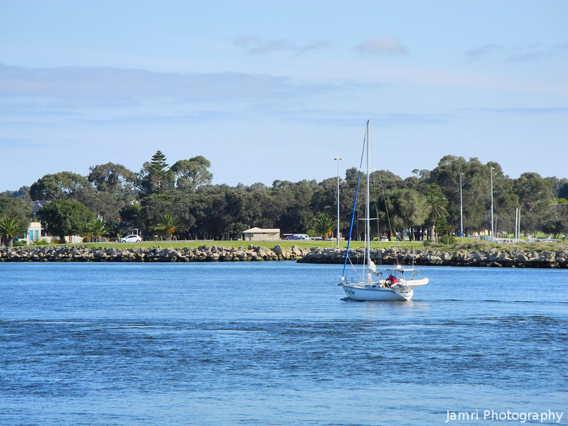 Against the tide.<br /> At boat travels into the Mandurah Estuary as tide goes out.