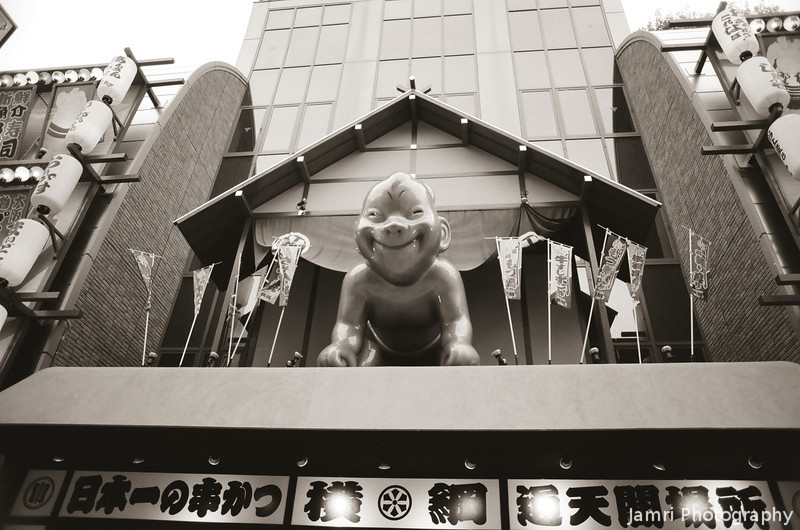 Baby Billiken?<br /> On top of a restaurant in Shinsekai.<br /> Note Film Shot: Nikon F80 + 24f/2.8 + PO1 Green Filter, Kodak 100 TMax Film.<br /> Split toned with the Gimp.