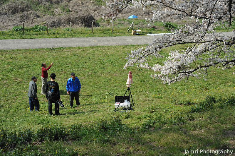 Photographing a doll on tripod.<br /> Why? One of those only in Japan things...