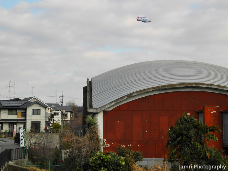 An Airship and a Gymnasium.<br /> Taken while on our walk back to my house from our Hike in the Mountains.