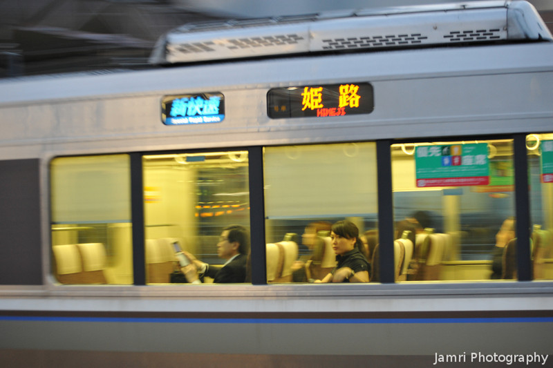 A Glance.<br /> The lady appears to be still in the middle of the moving train.