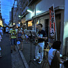 A Saxophonist in a Side Street.<br /> During the 2012 Gion Matsuri in Kyoto. Most of the music was traditional, but there were a few other musicians making the most of the fact the streets were crowded with festival goers.