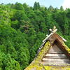 Thatched Roof in front of a Green Hill.<br /> In Miyama-cho, Nantan-shi, Kyoto-fu, Japan.