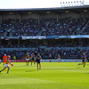 About to Kick.<br /> A Richmond player about to kick towards the goal at the Fremantle Dockers v Richmond Tigers AFL game at Subiaco Oval. I my memory serves me correctly he missed the goal (worth 6 points) and got a behind (worth 1 point).