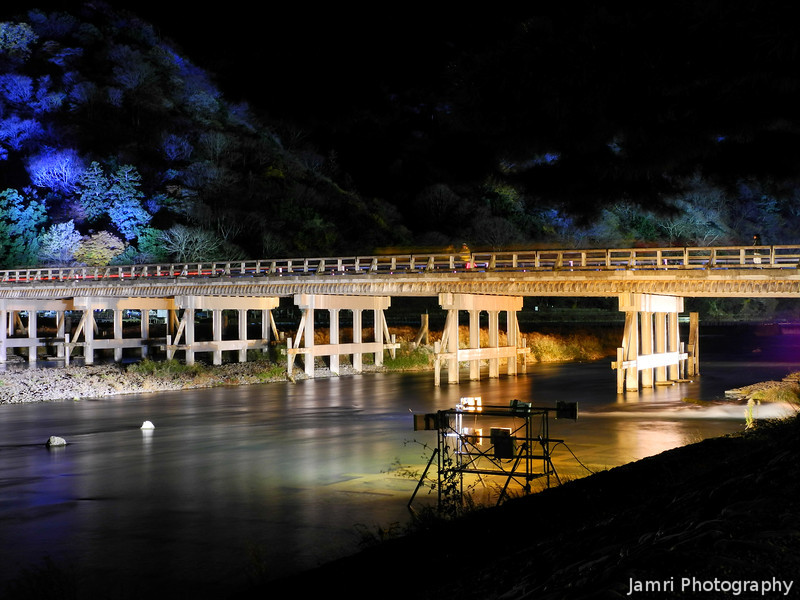 "A Behind the Scenes Look at the Arashiyama Hanatouro. I moved back further to where the lighting rig that was lighting up the Togetsukyo (""moonlight crossing bridge"") could be seen in the shot. The <a href=""http://jamri.smugmug.com/keyword/arashiyama-hanatouro"">Arashiyama Hanatouro</a> is held for 10 days every year in December, there's so much to see. I've been every year over the last four years (twice in 2009) and I still haven't seen it all. This was my last shot from the event, this was just before they switched the lights off for the evening. The temperature was around 0 degrees Celsius at the time. I hope to be at the <a href=""http://jamri.smugmug.com/keyword/higashiyama-hanatouro"">Higashiyama Hanatouro</a> (it's sister event) in this coming March, hopefully it will be a bit warmer weather for that, but March is still very much winter in Kyoto!"