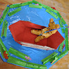 A bear fishing in a boat.<br /> One of items on display at the annual Megumi Kindergarten Art Exhibition.
