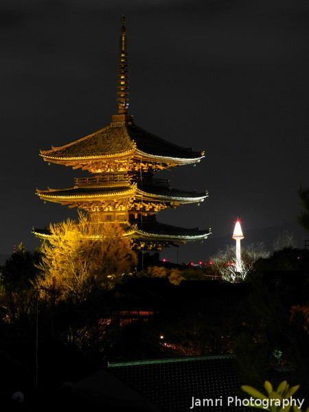 A Portrait of the Two Towers.<br /> Yasaka Pagoda at Hokan-ji in the foreground, The Kyoto Tower in the background.<br /> Lit up for the Higashiyama Hanatouro.