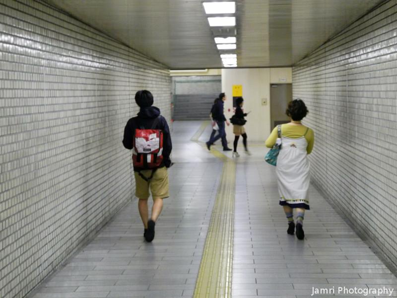 Walking down a very plain passage.