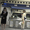 Kyoto where Ancient meets Modern.<br /> And things are never what they initially appear to be. Two young ladies both using mobile phones. One dressed like an office worker in a black suit, the other wearing a white Kimono. However this is a Sunday evening are they just dressed up for an occasion, or do they both wear this kind of clothing all the time?<br /> The story of this shot: I was just about pack my gear in the camera bag when noticed this scene unfolding on the opposite platform. With camera in my lap using live view I composed without being noticed, however for some reason live view wouldn't take a shot, so I switched it back to the viewfinder and shot it blindly with the camera still in my lap.