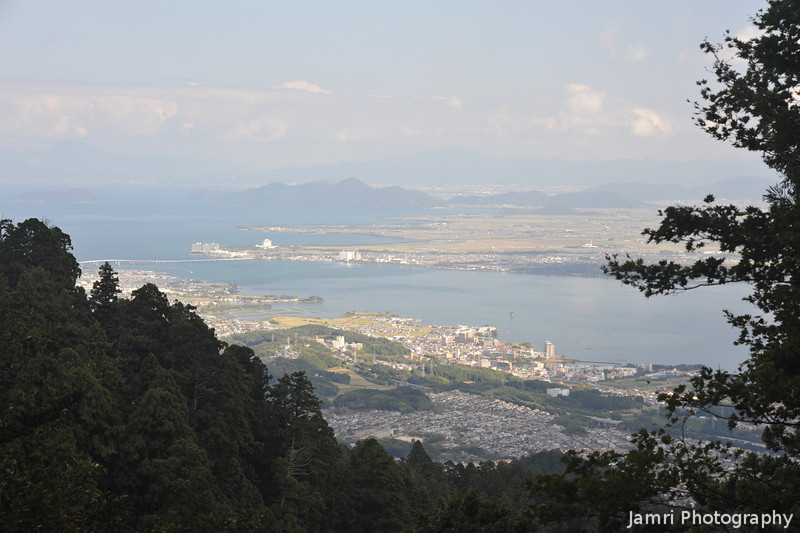 Lake Biwa through the trees.<br /> From near the Cable Enryakuji Station on Mt. Hiei.