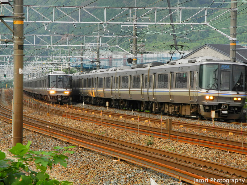 Two Trains.<br /> Both headed towards Kyoto city. The one on the outer tracks is a Special Rapid Service which runs non-stop from Takatsuki to Kyoto. The one on the inner tracks is a Local Service which stops at all stations.