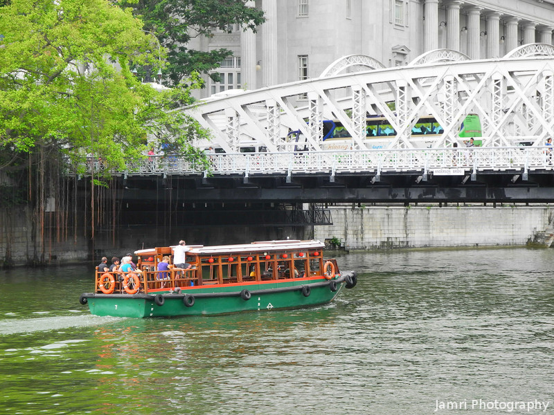 Heading Upriver.<br /> A Bum Boat carrying tourists.